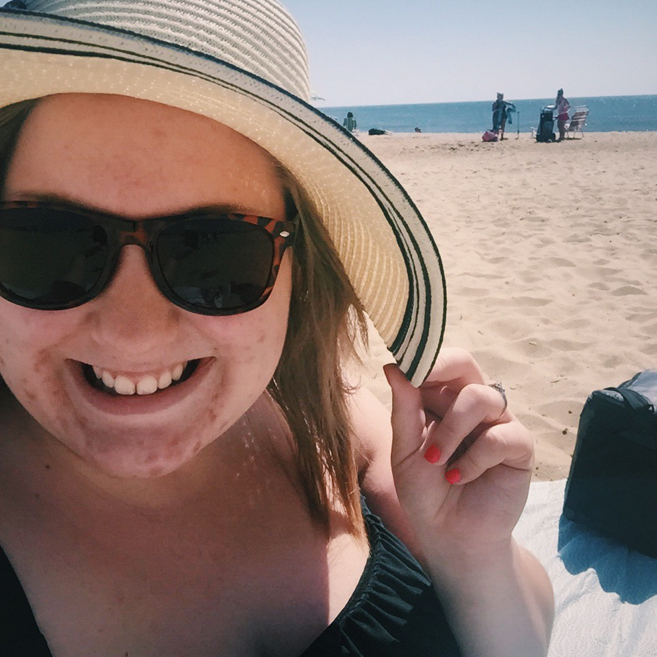 the face of a beach loving girl who is wicked excited for the first (of many) beach days of the year!