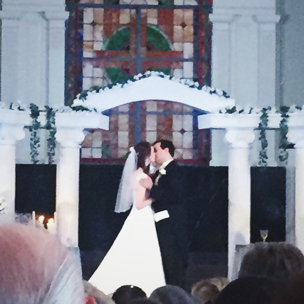 First kiss as husband and wife! Sorry for the poor quality, I was pretty far back in the church. Love this couple!