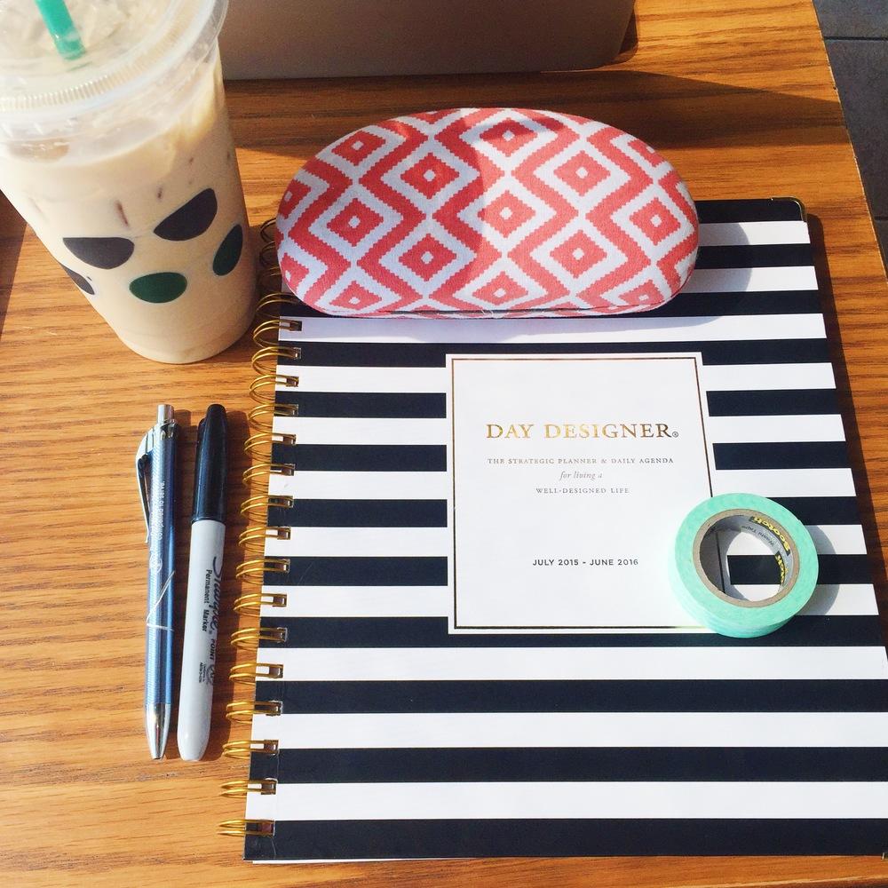 My new Day Designer Planner! I'm obsessed. Also, starbucks.