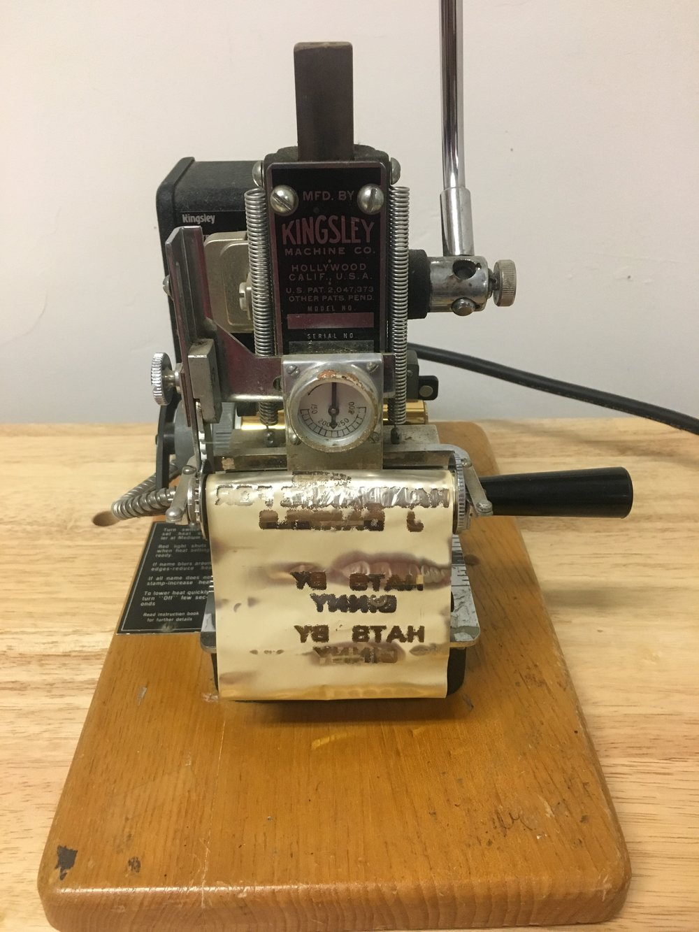 Kingsley M50 Foil Stamping Machine. Circa 1940's. I believe this is the model from research and pictures I have found on ebay and Facebook. The model and serial number are worn off. I use this to stamp the sweatbands. Kicking it old school around here.
