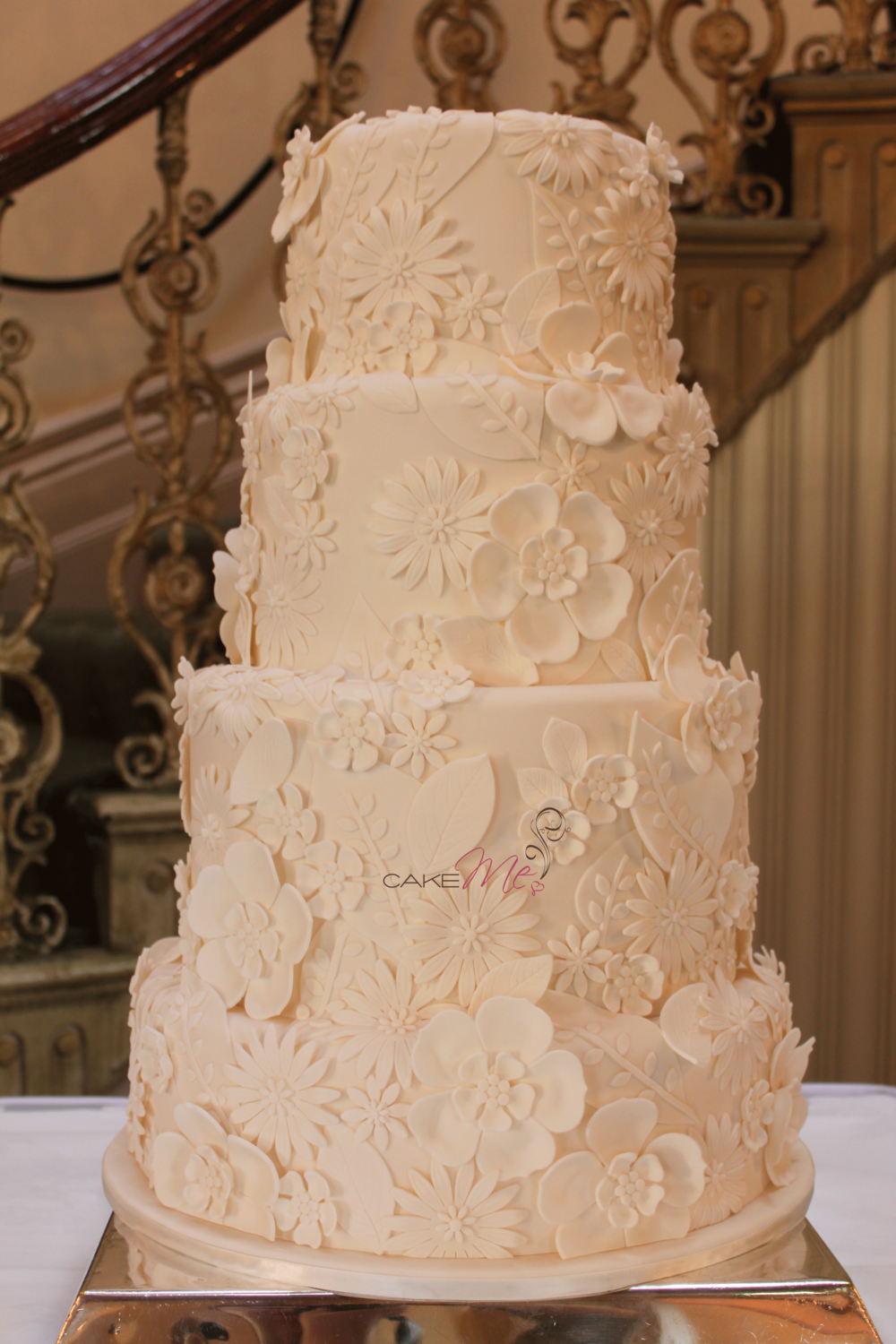 Four tier ivory lace applique wedding cake