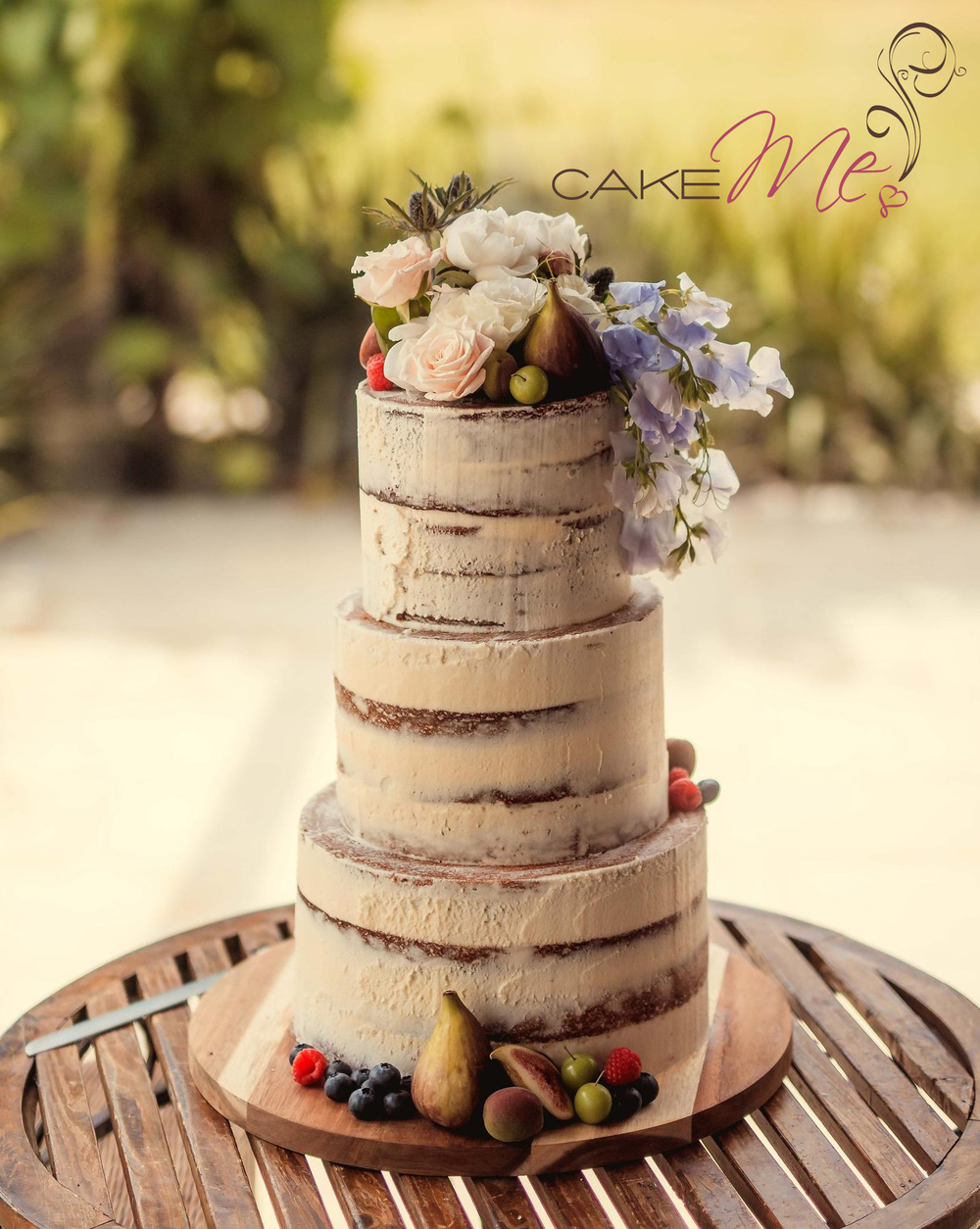 Joy and Warren's semi naked cake, adorned with gorgeous blooms and hand selected fruit.