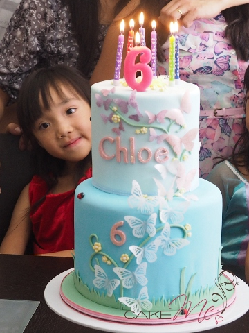 My shy little niece, Chloe, hiding behind her cake.