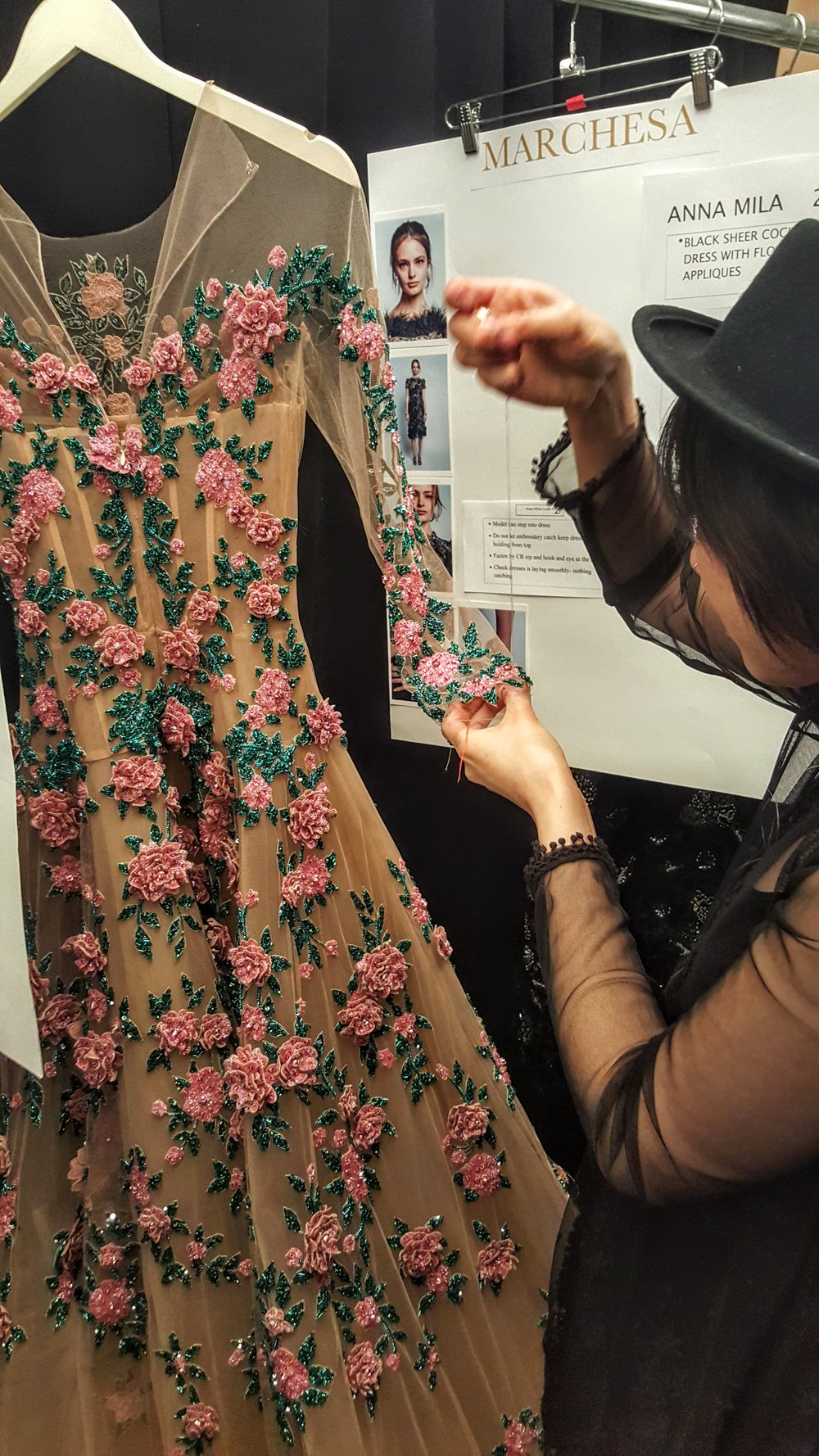 Minutes before showtime, a seamstress tirelessly works on finishing touches on one of the gowns - so stunning, I thought I was going to hyperventilate with glee.