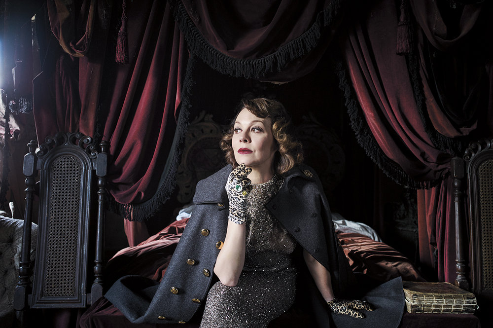 Helen McCrory wearing jacket by Dolce & Gabbana, dress by Elizabeth Emmanuel, gloves by Cornelia James and rings by Ritz Fine Jewellery