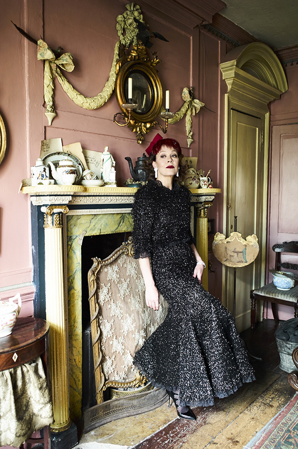 Helen McCrory wearing dress and shoes by Dolce & Gabbana, hat by Stephen Jones, earrings and bracelet by De Beers
