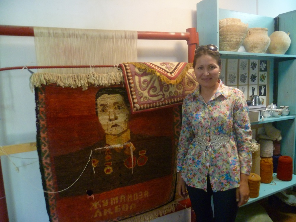Ursia, textile conservator, posing next to her ongoing project.jpg