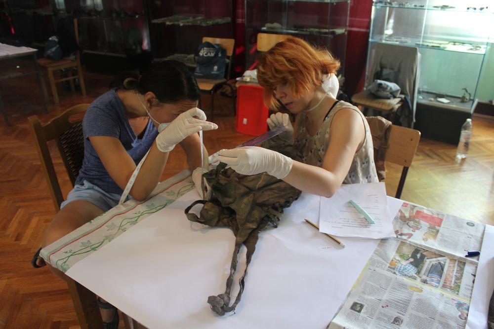 One Organics team assessing the miner's bag.