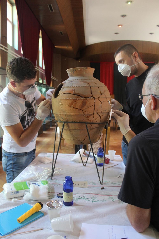 Ceramics team starting work on cleaning their Roman pot.
