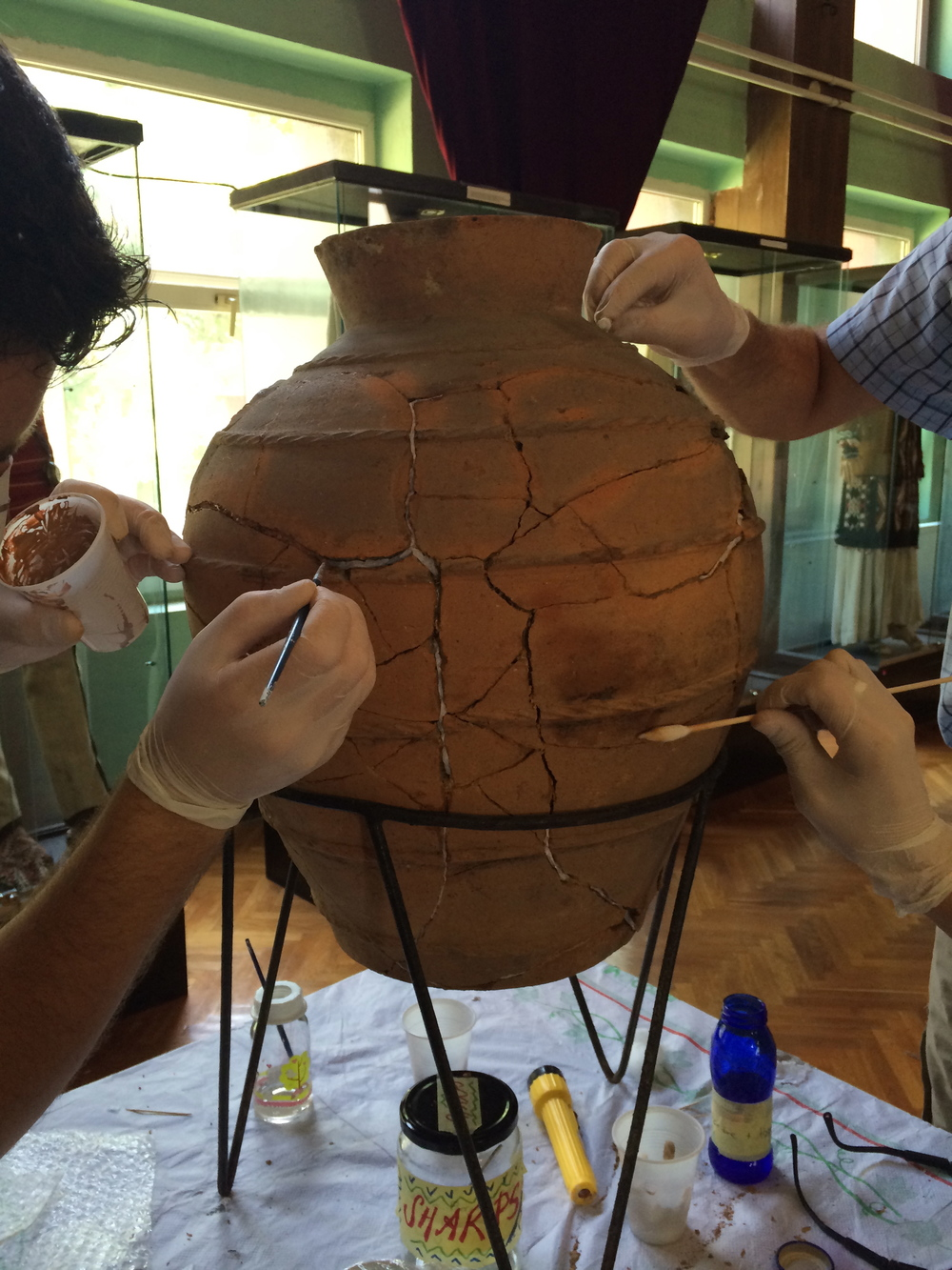 Making last minute touches to the earthenware pithos