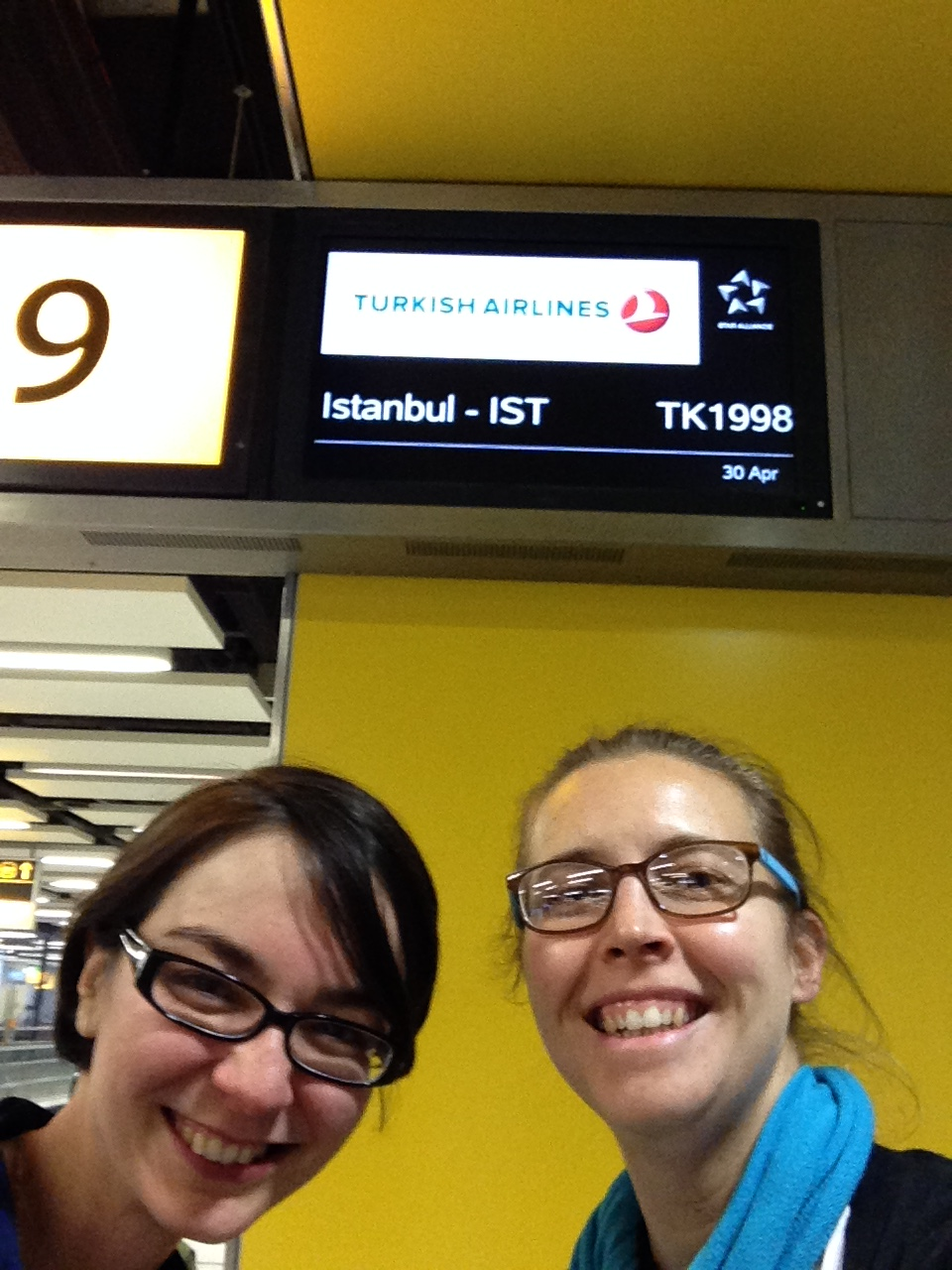 Glasses and smiles: at Gatwick airport, about to board an Istanbul-bound flight on our way to Almaty, Kazakhstan