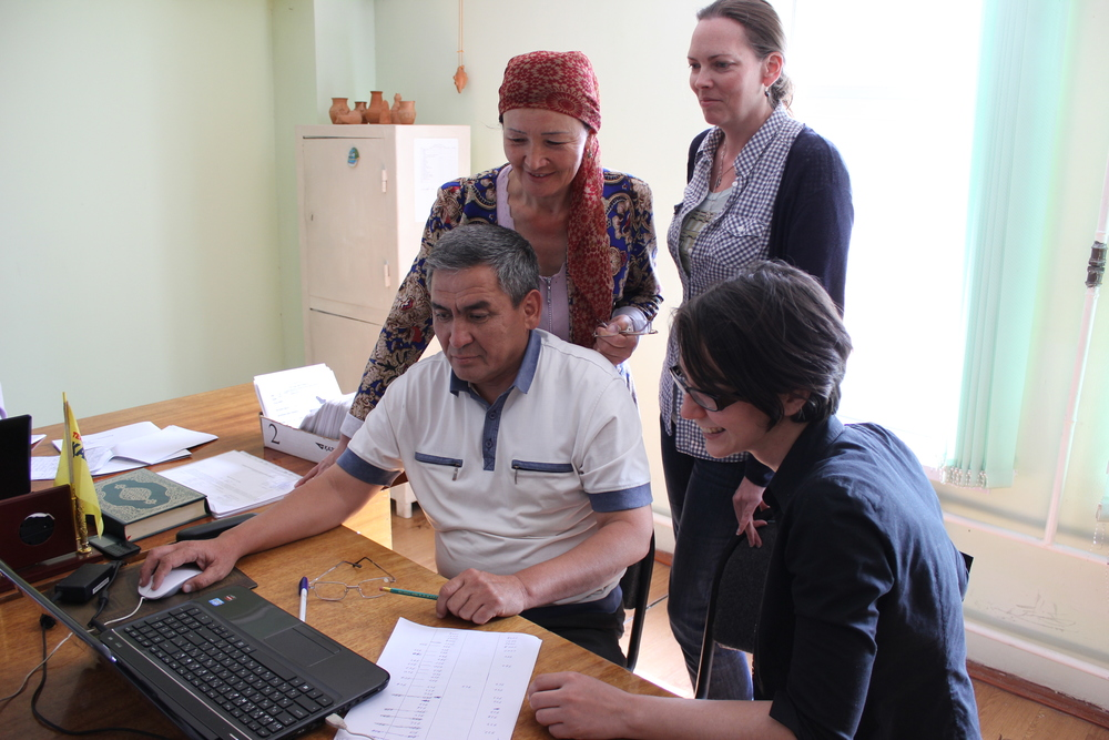 Checking out the image database with Documentation Officer Hamid and Collections Keeper Karlaghash.