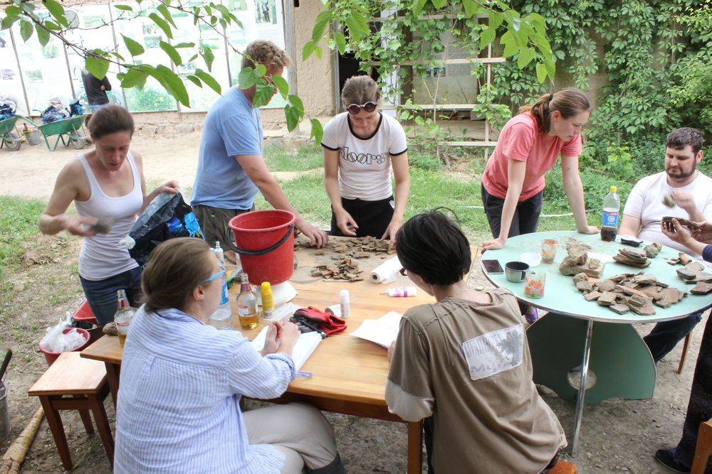 End of day finds processing - weighing and counting.  From left to right; Natalie, Odile, Jon, Karina, Katya, Jonathan and Maria.
