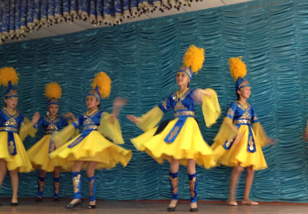 Students give a performance of traditional Kazakh dance with colourful traditional costumes
