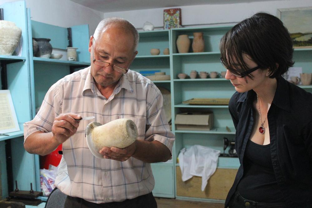 Sartai working on the ceramic pot