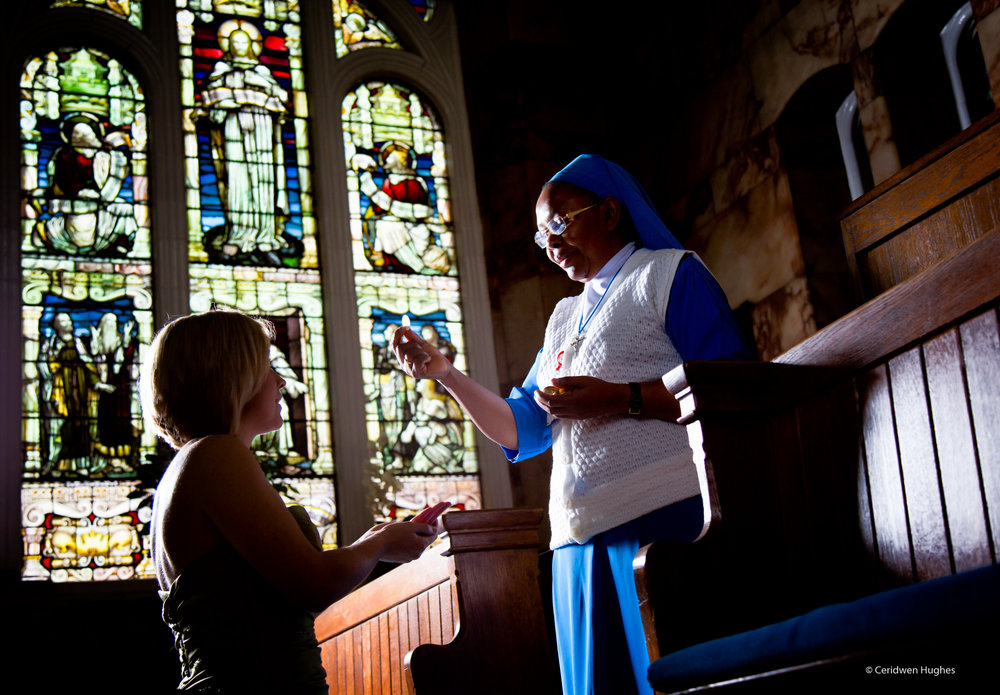 Nun and mother in chapel
