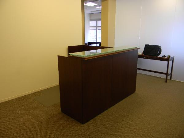 N5 - Reception desk with smoke glass transaction counter. 6'x 6' with BBF and 2dr lateral file.  Very nice.