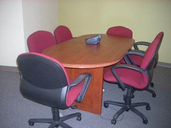 6' Cherry racetrack conference table. (Shown here with Steelcase Rally task chairs in Burgundy)