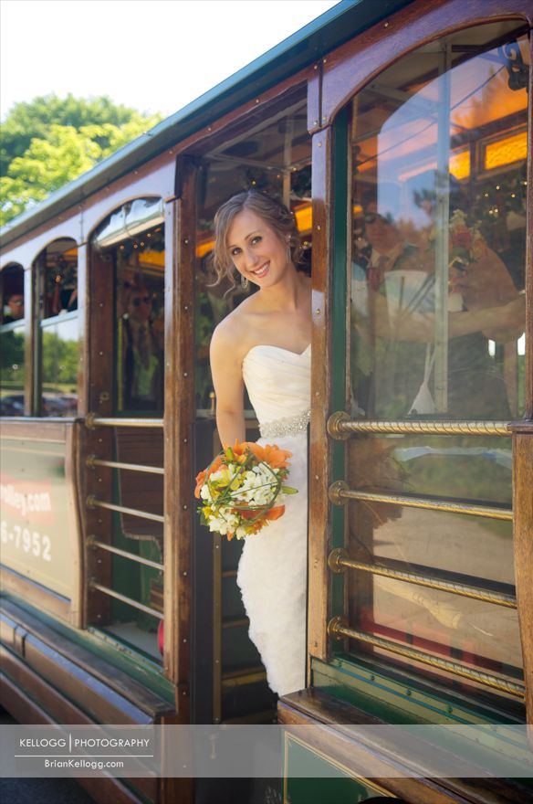 Bride hanging off of Trolly