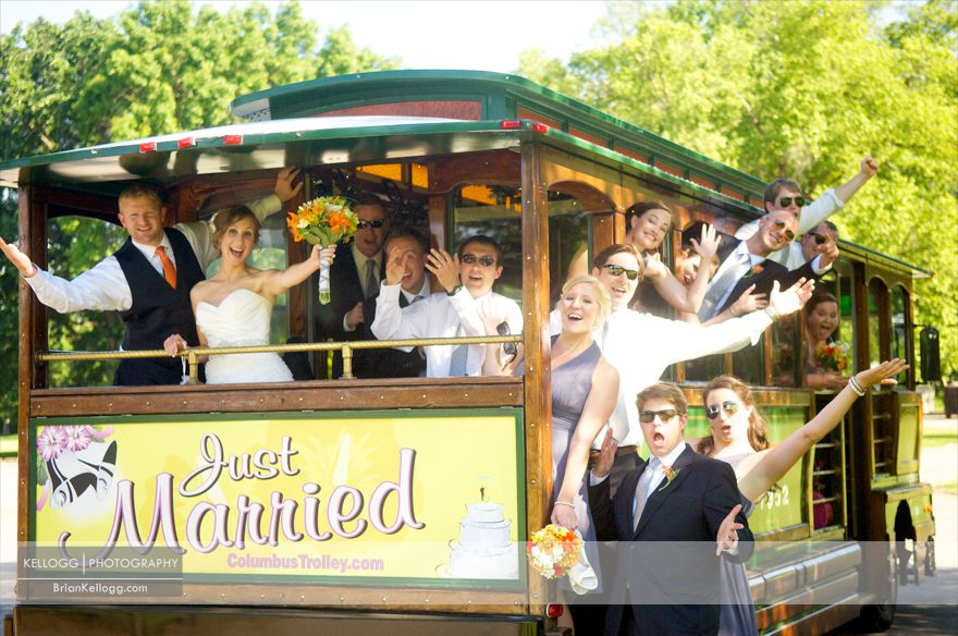 Wedding Party hanging off Trolly Photo