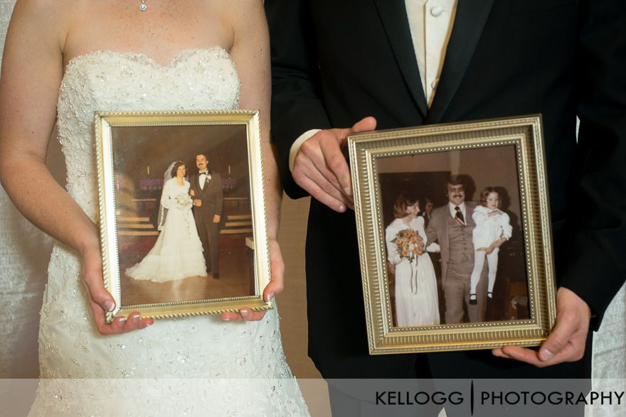 holding parents wedding photos on wedding day