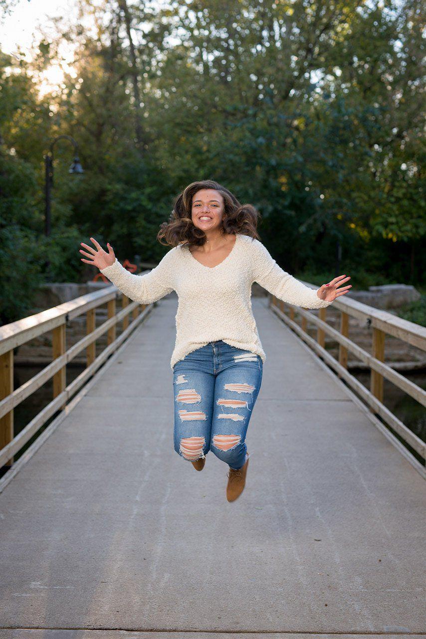 Jumping on a bridge Senior Portrait