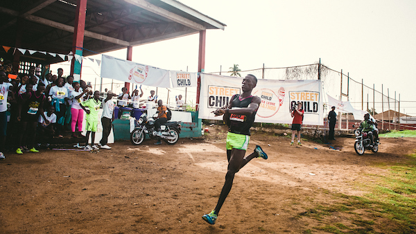 Mustafa 'Eskimo' Kamara about to cross the finish line as the winner of the 2016 Sierra Leone Marathon
