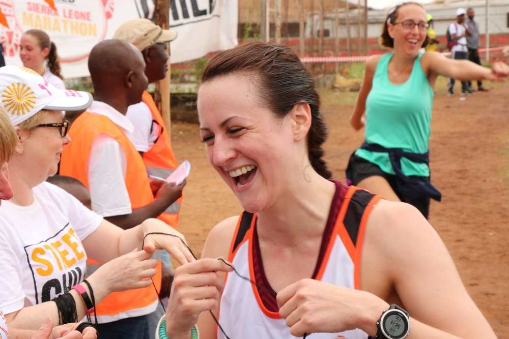 Laura Murray at the finish line.JPG