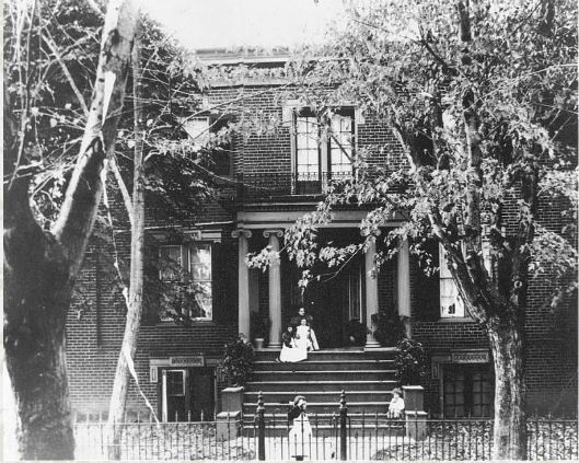 The Warren-Sipe House as it appeared in the 1880s. Notice that at that time, the porch was only a stoop, the brick had not yet been painted white, and the roof was still flat.