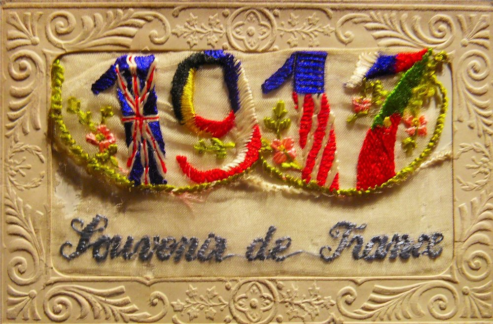 "World War I Silk Postcard featuring Allied Forces flag motif and text ""Souvenir de France"""