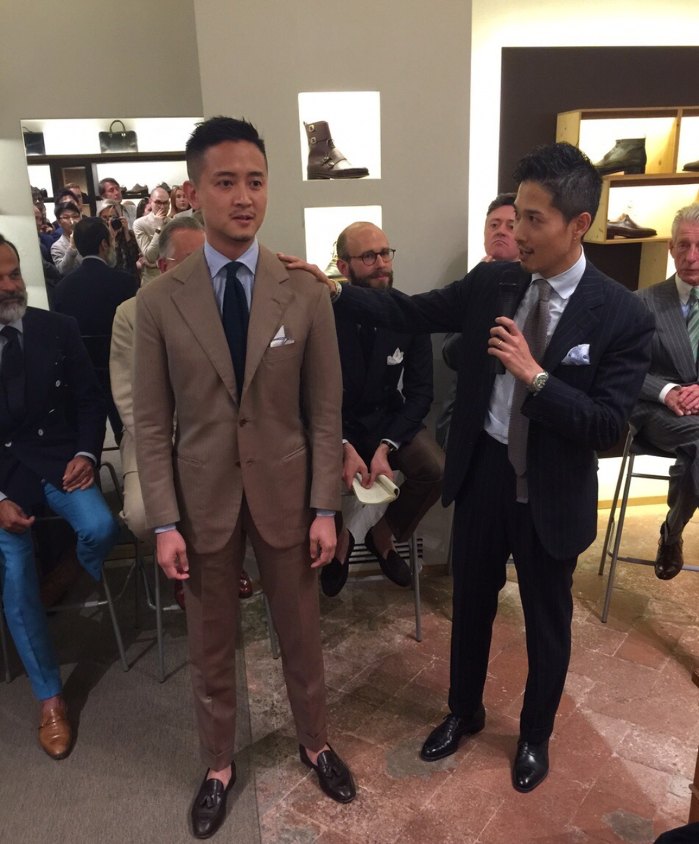 (Alan See, The Armoury Hong Kong serves as a demonstration model as Takahiro Osaki (AKA Taka), Liverano & Liverano discusses and shows the crowd what lies behind the art and craftsmanship of a Liverano Bespoke Garment.