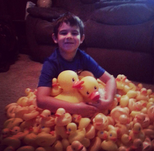 Jaden with donated rubber duckies Photo Credir: Tasha da Silva