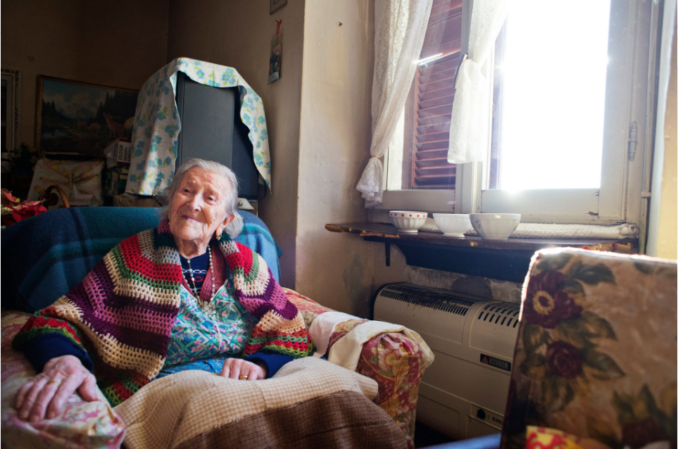 Emma Morano in her home in 2015 in Verbania, Italy. Then she was the 5th oldest person in the world.  Now she is the oldest. Photo Credit Alessandro Grassani for The New York Times