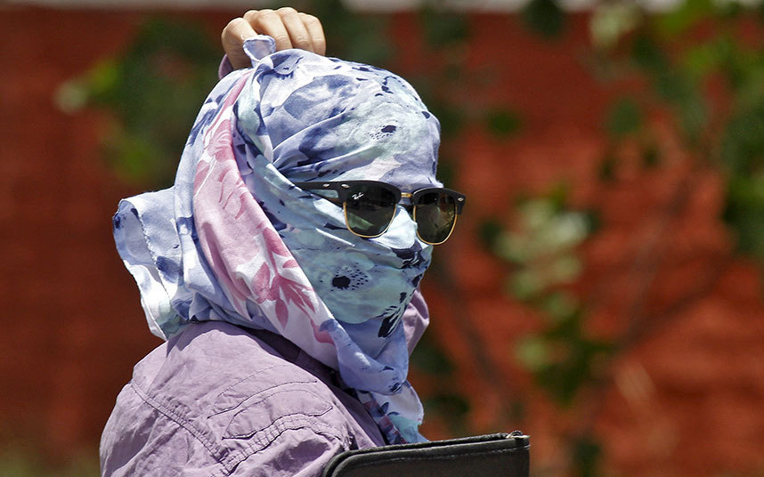 Woman protecting herself from heat stroke. Picture: REUTERS/Ajay Verma
