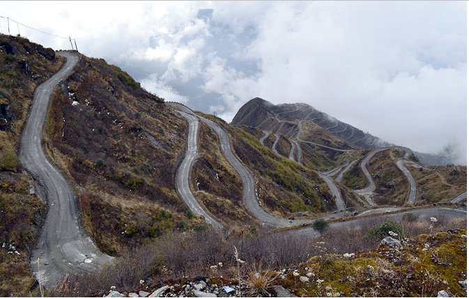 Photo: Kaushik Das; A view of the winding, switchback roads in Sikkim.