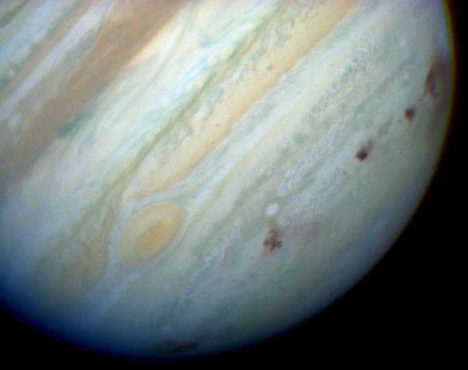 Brown spots mark Comet Shoemaker–Levy 9 impact sites on Jupiter's southern hemisphere.