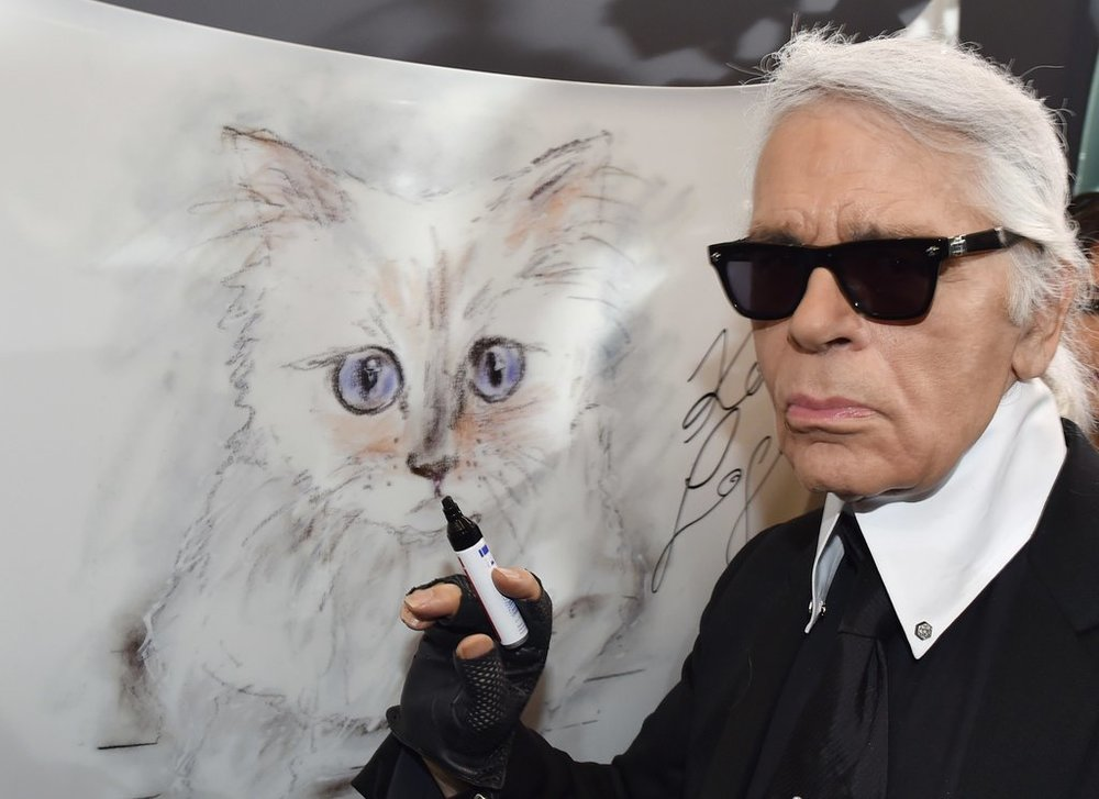Mr. Lagerfeld in Berlin in 2015 with a painting of Choupette, his Birman cat.