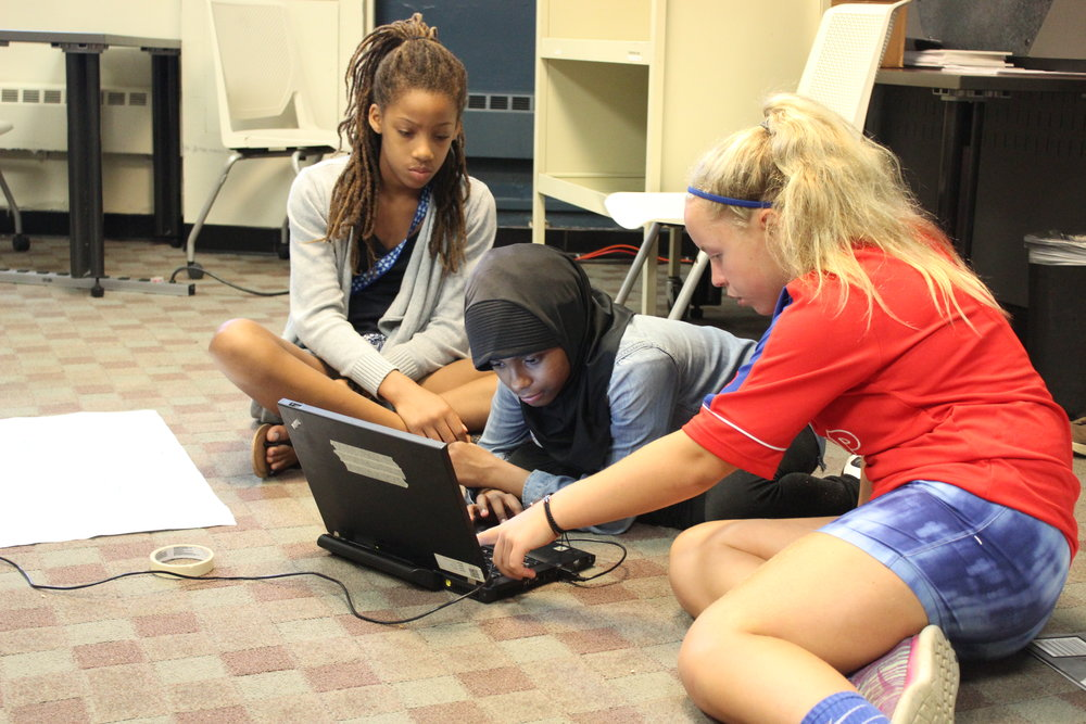 The girls worked in groups to program their robots.