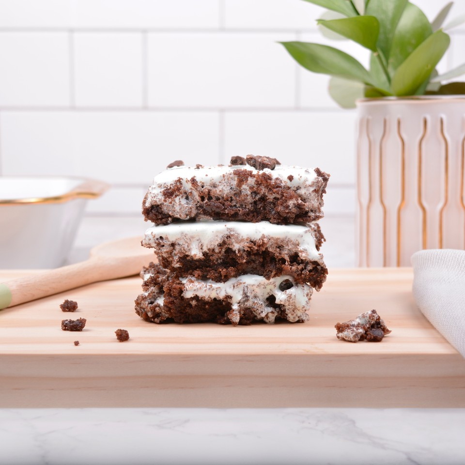 winter 2019 - chocolate mint brownies   i made these brownies to help promote our new bar, mintfully brownie. these are chocolate brownies with mint marshmallow fluff toppings. i started taking a food photography course and started applying what i learned to these images.