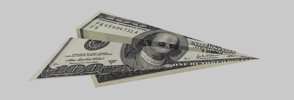 dollar-plane-picture-id493220080.jpg