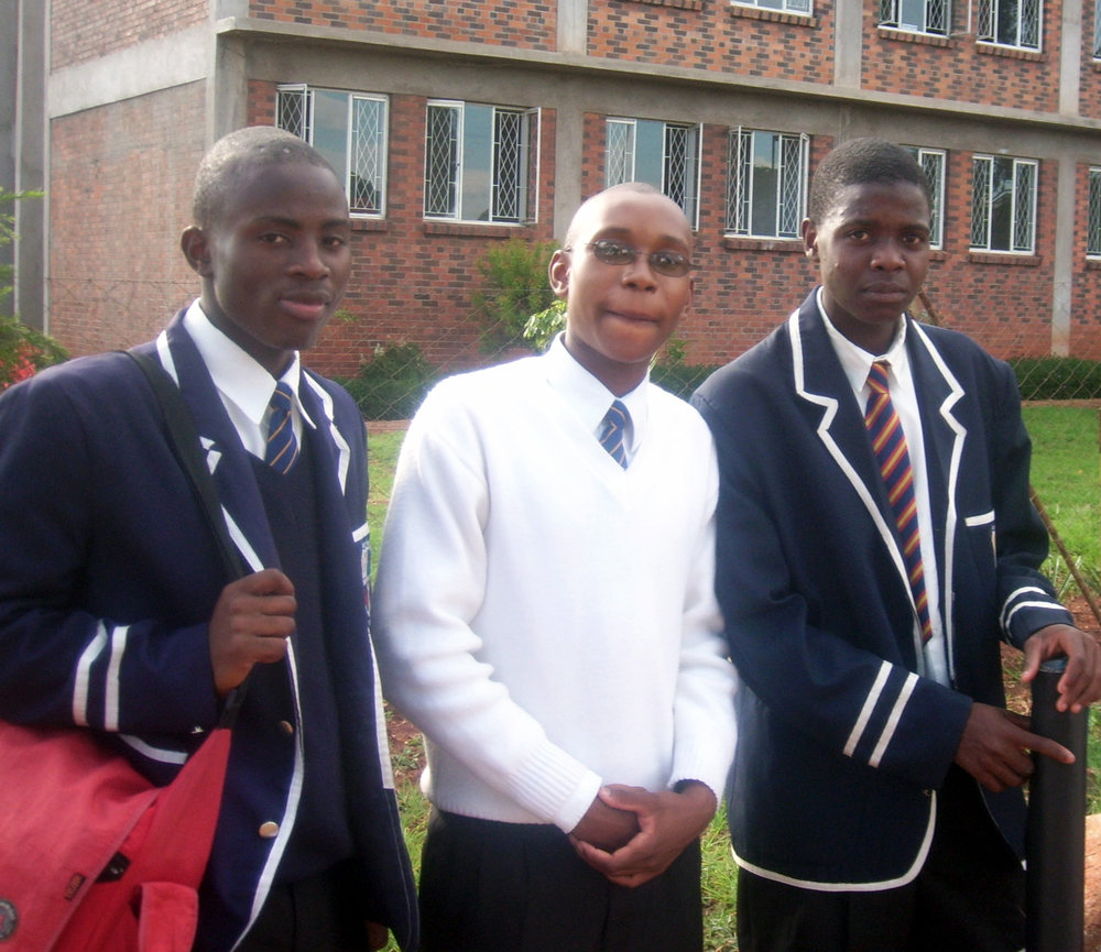 Tapiwa (far left) at boarding school