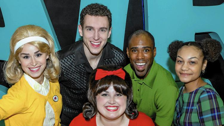 "Clockwise from left, Samantha Pauly as Amber Von Tussle, Henry McGinniss as Link Larkin, TJ Crawford as Seaweed J. Stubbs, Ariana Burks as Little Inez, and Amelia Jo Parish as Tracy Turnblad, star in ""Hairspray"" at the Paramount Theatre in Aurora. (Paramount Theatre / Handout)"