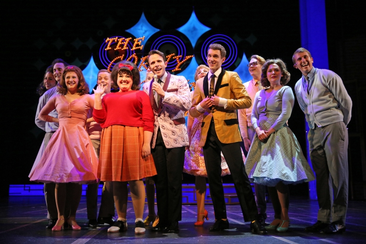 (front trio, from left) Amelia Jo Parish is Tracy Turnblad, Devin DeSantis is Corny Collins and Henry McGinniss plays Link Larkin - See more at: Broadway World