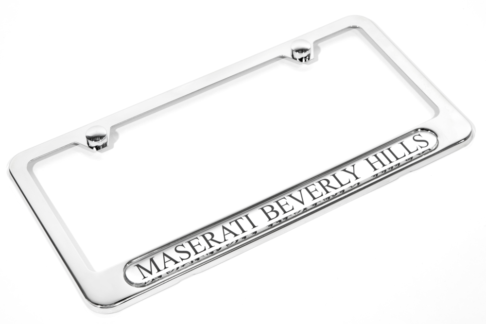 Polished stainless steel license plate frame, featuring a high gloss silver, and black nameplate graphic.