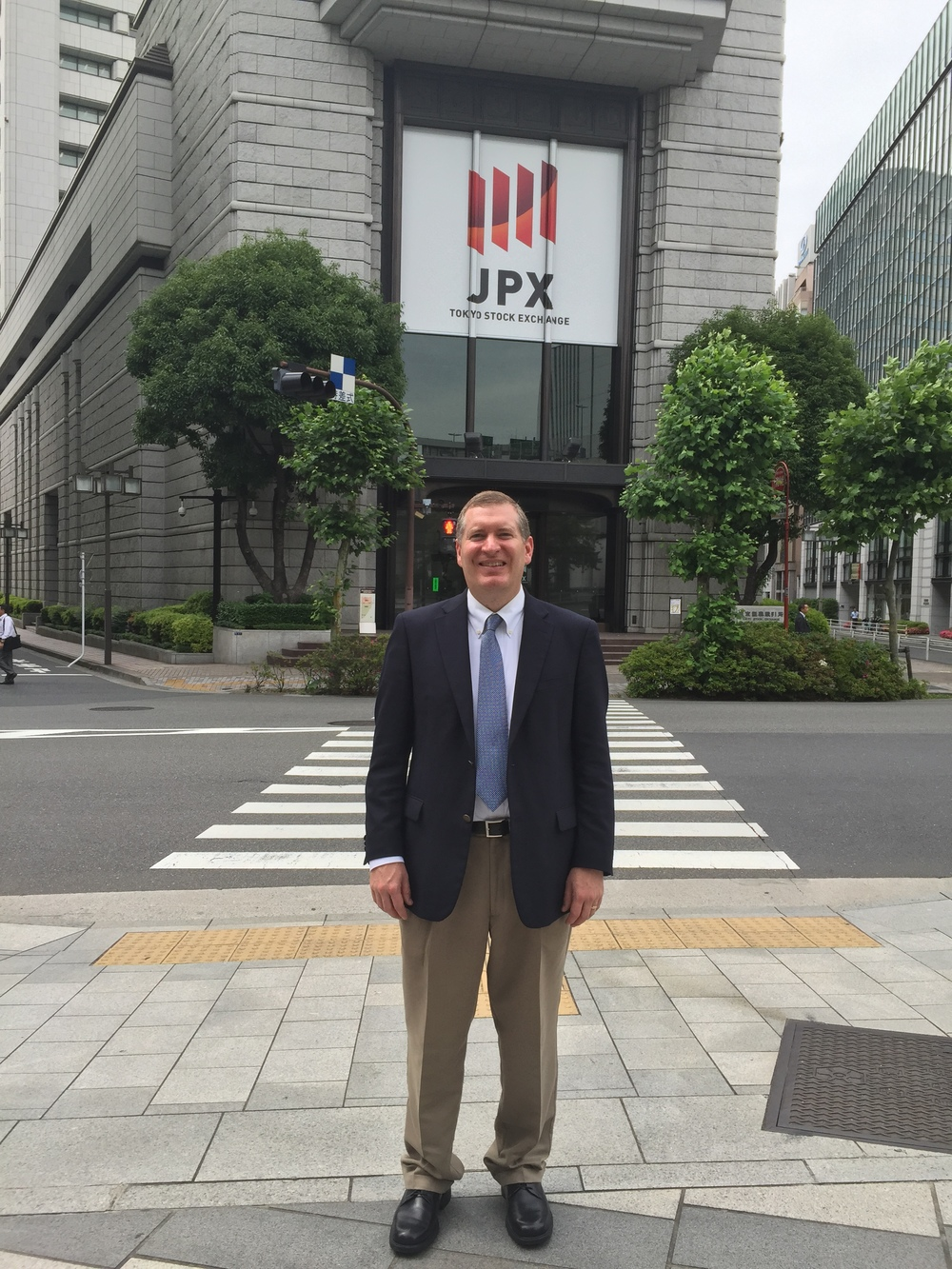 John Lunt in front of the Tokyo Stock Exchange