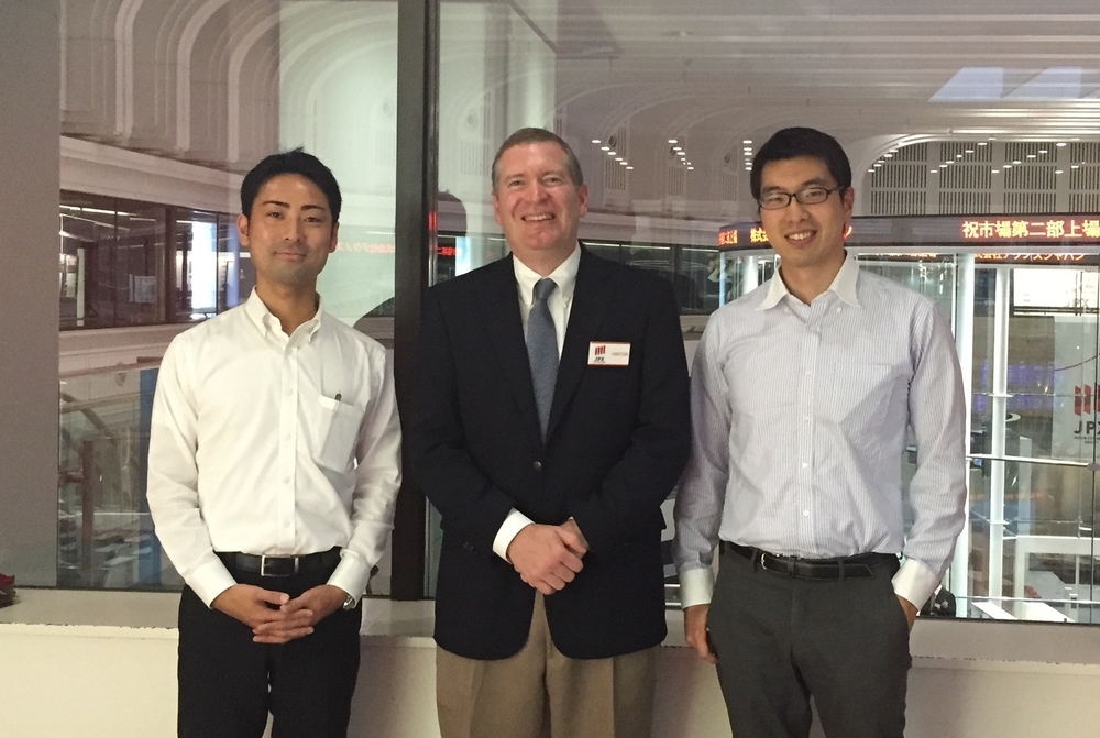 John Lunt with Shun Takato (left) and Goki Sakaguchi (right) at the Tokyo Stock Exchange