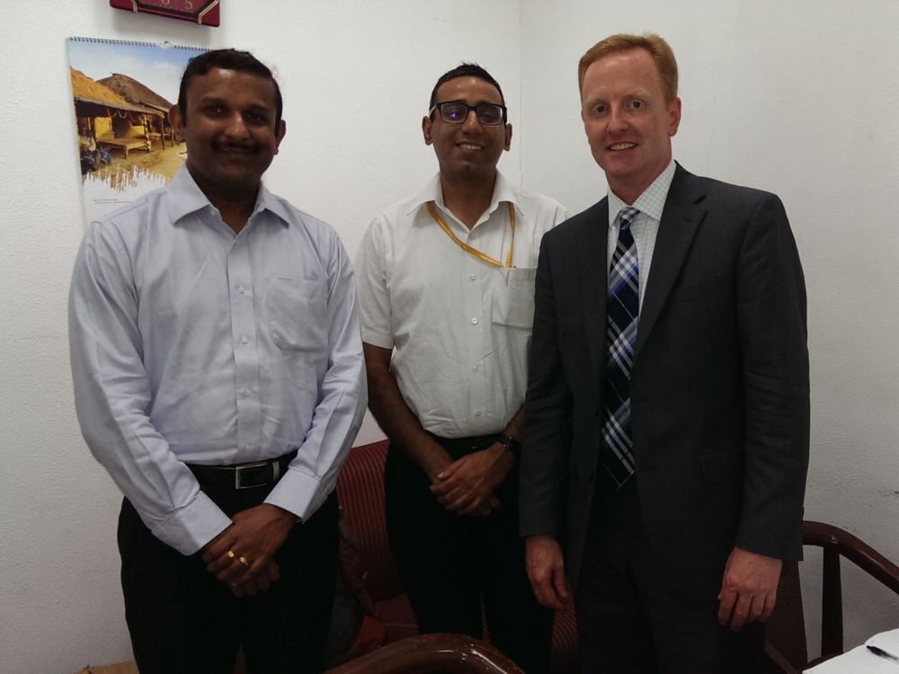 Ryan Hessenthaler with Jitesh John and Nikhil Varma of the Ministry of Finance