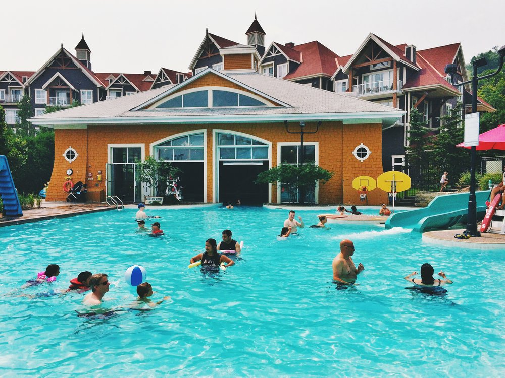 Summer 2016 Photo: Plunge Pool @ Blue Mountain Resort.  You can't tell from this pic, but inside the yellow building is more pool and an amazing indoor splash pad and climbing area for tots. Did I mention it's also heated?!