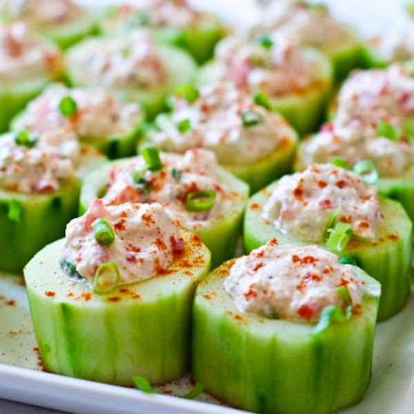 CREAMY CUCUMBER HUMMUS CUPS:  Creamy and sweet red pepper hummus, seasoned with a blend of exotic spices in a cucumber vessel.