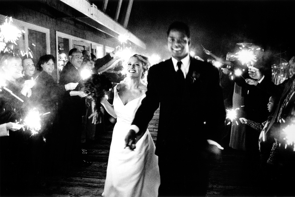 "Sparkler exit at midnight at Salty's in Seattle, WA. This was a winning image in PDN (Photo District News) ""Top Knots"" wedding photography contest in 2004."